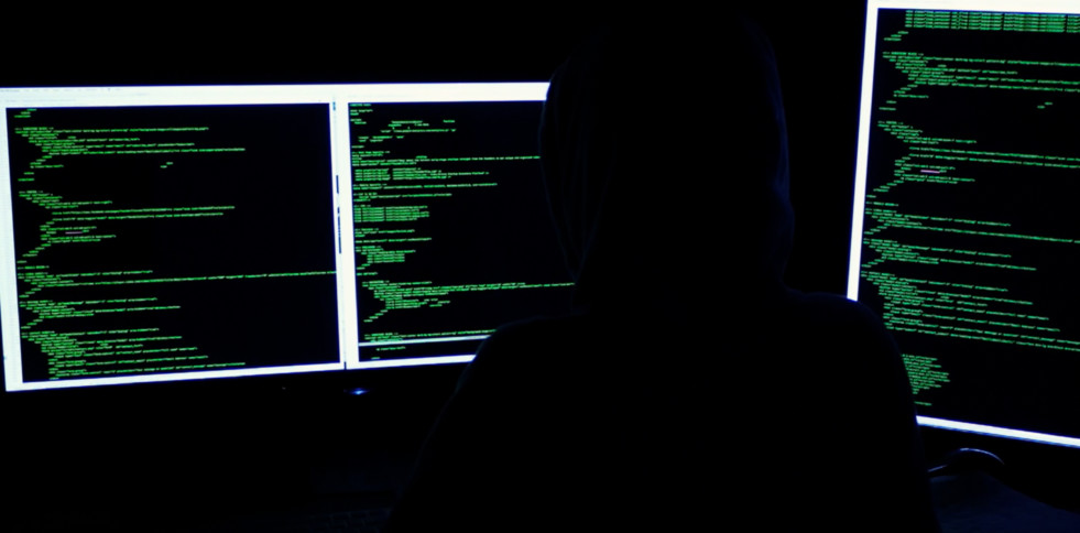 image of someone hacking on computers