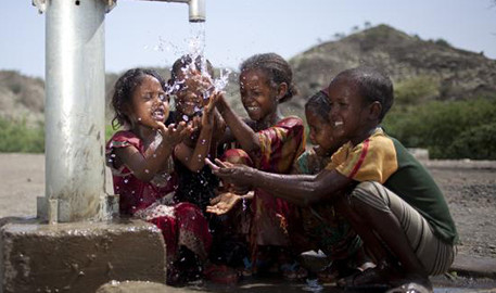 image of children playing in water